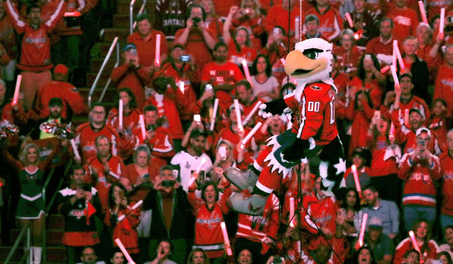 Washington Capitals mascot Slapshot is hoisted before Game 3 of the NHL hockey Stanley Cup Final between the Capitals and the Vegas Golden Knights, Saturday, June 2, 2018, in Washington. (AP Photo/Pablo Martinez Monsivais)