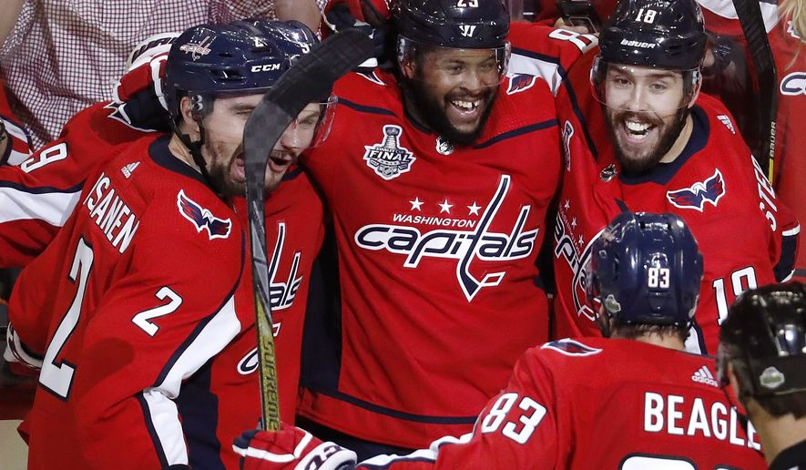 Washington Capitals forward Devante Smith-Pelly, center, celebrates with teammates after his goal against the Vegas Golden Knights during the third period in Game 3 of the NHL hockey Stanley Cup Final, Saturday, June 2, 2018, in Washington. (AP Photo/Pablo Martinez Monsivais)