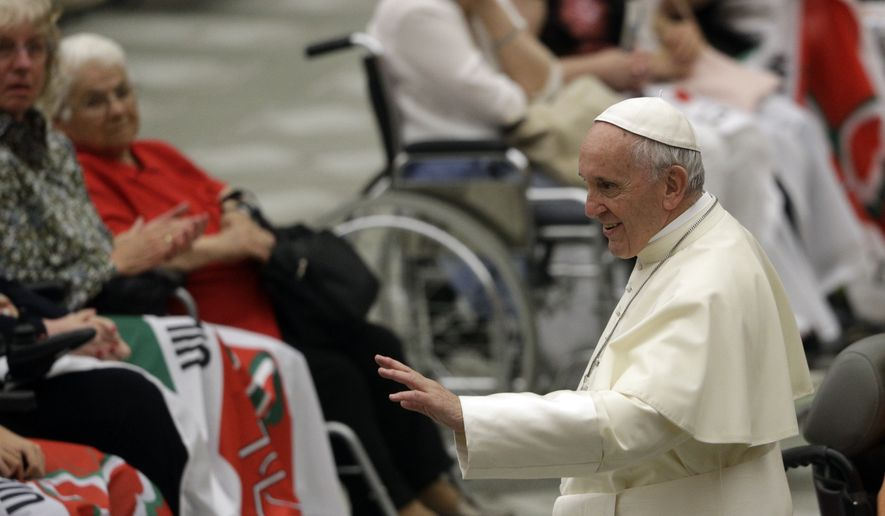 Pope Francis meets with members of an Italian association fighting muscular dystrophy at the Vatican, Saturday, June 2, 2018. (AP Photo/Gregorio Borgia)