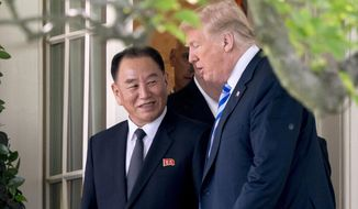 President Donald Trump talks with Kim Yong Chol, former North Korean military intelligence chief and one of leader Kim Jong Un's closest aides, as they walk from their meeting in the Oval Office of the White House in Washington, Friday, June 1, 2018. (AP Photo/Andrew Harnik)