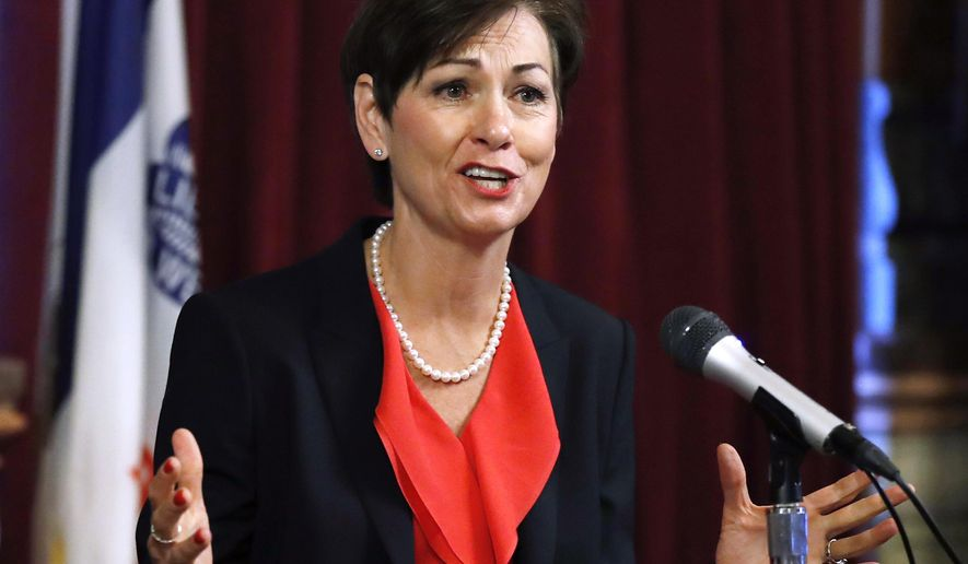 FILE - In this May 25, 2017, file photo, Iowa Gov. Kim Reynolds speaks during a news conference at the Statehouse in Des Moines, Iowa. Reynolds signed into law Wednesday, May 30, 2018, state tax cuts of $2.8 billion over six years, touting the benefits for the middle class. Most changes in personal income tax rates go into effect in tax year 2019, including lower rates for all income brackets. (AP Photo/Charlie Neibergall, File)