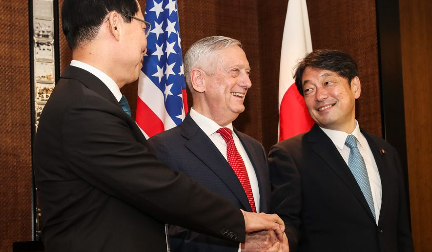 """""""We can anticipate, at best, a bumpy road to the [negotiations],"""" said Defense Secretary James N. Mattis, center. He met with South Korea's National Defense Minister Song Young-moo, left, and Japan's Defense Minister Itsunori Onodera for the 17th International Institute for Strategic Studies Shangri-la Dialogue, an annual defense forum in Asia, in Singapore, on Sunday. (ASSOCIATED PRESS)"""