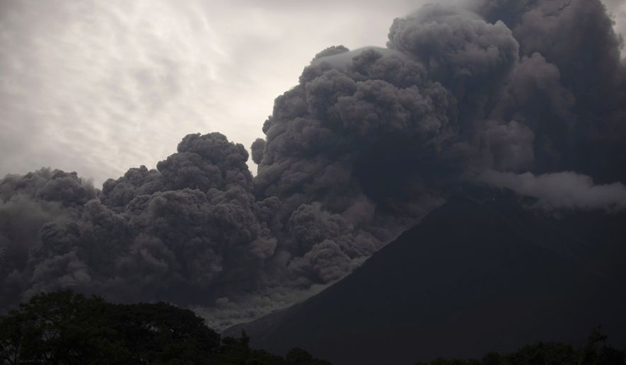 Volcan de Fuego, or Volcano of Fire, blows outs a thick cloud of ash, as seen from Alotenango, Guatemala, Sunday, June 3, 2018. One of Central America's most active volcanos erupted in fiery explosions of ash and molten rock Sunday, killing people and injuring many others while a towering cloud of smoke blanketed nearby villages in heavy ash. (AP Photo/Santiago Billy)