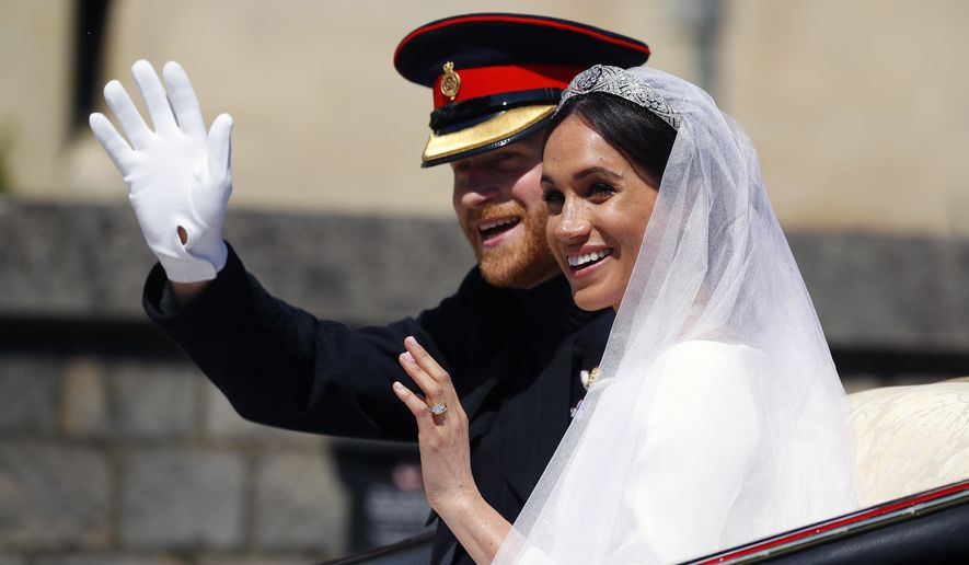 Britain's Prince Harry and his wife Meghan Markle ride a horse-drawn carriage, after their wedding ceremony at St. George's Chapel in Windsor Castle in Windsor, near London, England, Saturday, May 19, 2018. (Phil Noble/pool photo via AP)