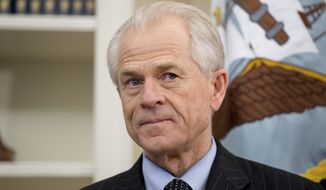 FILE - In this March 31, 2017 file photo, National Trade Council adviser Peter Navarro appears before President Donald Trump arrives to sign executive orders regarding trade in the Oval Office at the White House in Washington. After striking a delicate deal with the United Arab Emirates on rules for airline competition, the Trump administration went to war with itself about what the agreement actually said. White House trade adviser Peter Navarro repeatedly contradicted the State Departments carefully crafted script. Behind the scenes, a dizzying scene of one-upmanship, word games and subtle subterfuge played out, magnified by lobbyists seeking to exploit divisions within the Trump administration. (AP Photo/Andrew Harnik)