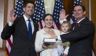 FILE - In this Jan. 3, 2017, file photo, House Speaker Paul Ryan of Wis. administers the House oath of office to Rep. Austin Scott, R-Ga., during a mock swearing in ceremony on Capitol Hill in Washington. The Republican newcomers stunned Washington in the 2010 midterm election, sweeping into the House majority with bold and boisterous promises to cut taxes, slash spending and rollback what many viewed as Barack Obamas executive overreach of the federal of government. Scott, the class president, objects to the tea party brand he says was slapped on the group by the media and the Obama administration. Its a label some lawmakers now would rather forget. We werent who you all said we were, Scott said.(AP Photo/Jose Luis Magana, file)