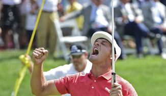 Bryson DeChambeau celebrates after beating Beyong Hun An, from South Korea, on the 18th hole in the second playoff hole during the final round of the Memorial golf tournament Sunday, June 3, 2018, in Dublin, Ohio. (AP Photo/David Dermer)