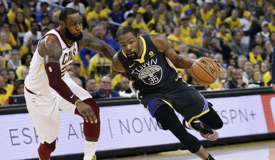 a633aa95ea868 Golden State Warriors forward Kevin Durant (35) drives against Cleveland  Cavaliers forward LeBron James