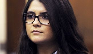 FILE - In this March 3, 2017 file photo, Nikki Yovino is arraigned in Superior Court, in Bridgeport, Conn. Jury selection in the case of Yovino is scheduled to begin Tuesday, June 5, 2018 in Bridgeport Superior Court in Connecticut. Yovino is accused of making up rape allegations against two college football players to gain the sympathy of another student she wanted to date. (Ned Gerard/Hearst Connecticut Media via AP, Pool)