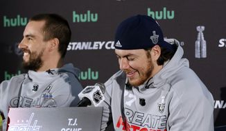 Washington Capitals defenseman Matt Niskanen, left, and forward T.J. Oshie share a laugh as they speak to the media, Sunday, June 3, 2018,  in Arlington, Va. The Capitals will host the Vegas Golden Knights in Game 4 of the NHL hockey Stanley Cup Final Monday night in Washington. (AP Photo/Bill Sikes)