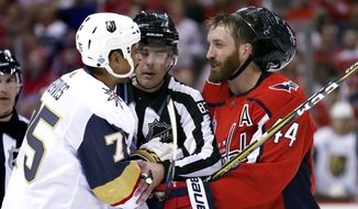 Linesman Matt MacPherson, center, steps in to separate Vegas Golden Knights forward Ryan Reaves (75) and Washington Capitals defenseman Brooks Orpik (44) during the third period in Game 3 of the NHL hockey Stanley Cup Final, Saturday, June 2, 2018, in Washington. (AP Photo/Alex Brandon) **FILE**