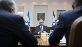 Israeli Prime Minister Benjamin Netanyahu, center, attends the weekly cabinet meeting at the Prime Minister's office in Jerusalem Sunday, June 3, 2018 (AP Photo/Sebastian Scheiner, Pool)