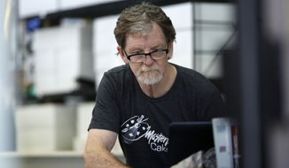 Baker Jack Phillips, owner of Masterpiece Cakeshop, manages his shop after the U.S. Supreme Court ruled that he could refuse to make a wedding cake for a same-sex couple because his religious beliefs did not violate Colorado's anti-discrimination law Monday, June 4, 2018, in Lakewood, Colo. (AP Photo/David Zalubowski)