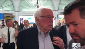 Vermont Sen. Bernie Sanders scurries away from Info Wars host Alex Jones during a run-in at LAX Airport on June 4, 2018. (Image: YouTube, Info Wars)