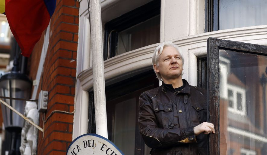 In this May 19, 2017, file photo, WikiLeaks founder Julian Assange greets supporters from a balcony of the Ecuadorian Embassy in London. (AP Photo/Frank Augstein, File)