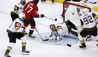 Washington Capitals forward T.J. Oshie (77) scores a goal past Vegas Golden Knights goaltender Marc-Andre Fleury (29) during the first period in Game 4 of the NHL hockey Stanley Cup Final, Monday, June 4, 2018, in Washington. (AP Photo/Pablo Martinez Monsivais)