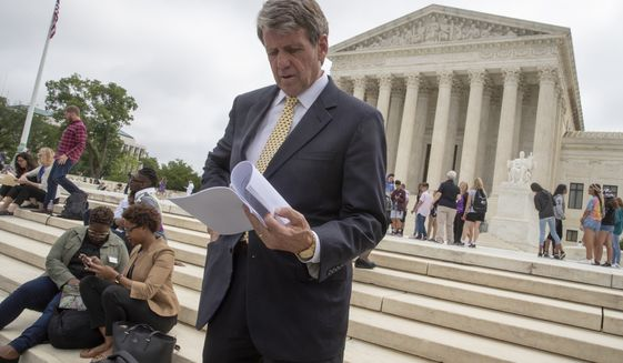 Michael Farris, CEO of the conservative Christian group Alliance Defending Freedom, looks at the decision in front of the Supreme Court, Monday, June 4, 2018 in Washington.  The Supreme Court has ruled for a Colorado baker who wouldn't make a wedding cake for a same-sex couple in a limited decision that leaves for another day the larger issue of whether a business can invoke religious objections to refuse service to gay and lesbian people.   (AP Photo/J. Scott Applewhite)