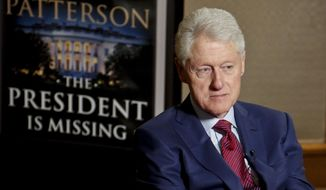 "Former President Bill Clinton listens during an interview about a novel he wrote with James Patterson, ""The President is Missing,"" in this May 21, 2018, photo in New York. (AP Photo/Bebeto Matthews) ** FILE **"
