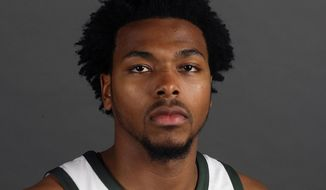 FILE - In this Sept. 25, 2017, file photo, Milwaukee Bucks' Sterling Brown poses for photos during NBA basketball team media day in Milwaukee. Newly released police videos showing the stun gun arrest of Bucks guard Sterling Brown show one officer stepping on Brown's ankle while he was handcuffed on the ground and others discussing the potential backlash of taking down an African American professional basketball player. Brown was arrested for a parking violation in Milwaukee in January.(AP Photo/Morry Gash, File)