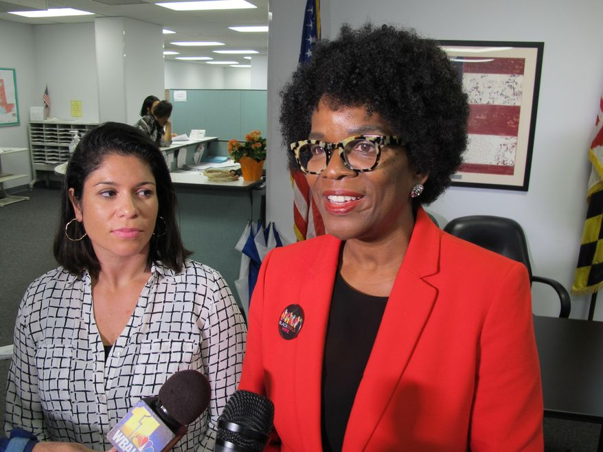 FILE - In this May 17, 2018, file photo, Valerie Ervin, right, announces her bid to run for governor at the Maryland State Board of Elections in Annapolis, Md. An attorney for Ervin, a Democratic candidate for governor, has urged the state elections board to reprint the ballot to show her client is running for governor, not as a running mate of a candidate who died suddenly. Mariana Cordier, an attorney for Ervin, said voters won't be fully informed the way the ballot is now. Ervin is suing the board, and a hearing is scheduled for Monday, June 4. (AP Photo/Brian Witte, File)