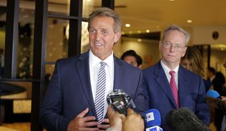 Sen. Jeff Flake (R-Ariz.) speaks to reporters next to Eric Schmidt, behind, former executive chairman of Google, in Havana, Cuba, Monday, June 4, 2018. (AP Photo/Desmond Boylan)