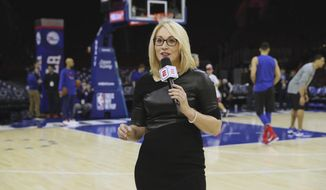 This Dec. 15, 2017, photo provided by ESPN Images shows Doris Burke before an NBA basketball game between the Boston Celtics and Philadelphia 76ers in Philadelphia.  Basketball has been part of Doris Burke's life for as long as she can remember. And it's not going away anytime soon. Burke and ESPN announced Monday, June 4, 2018, they have agreed on a multi-year contract extension, one that will see her retaining her role as a full-time NBA game analyst as well as a reporter for the conference finals and NBA Finals. (Allen Kee/Courtesy: ESPN Images via AP)