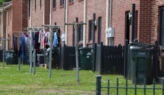 In this May 14, 2018, photo, clothes dry on a clothesline outside of the Cooper River Court apartment complex in Charleston, S.C. A new data analysis by the Center for Budget and Policy Priorities shows that tenants in Charleston receiving housing assistance could see the second-highest average annual increase in the United States under a new proposal by HUD Secretary Ben Carson to raise rents for millions of low-income households. (AP Photo/Robert Ray)