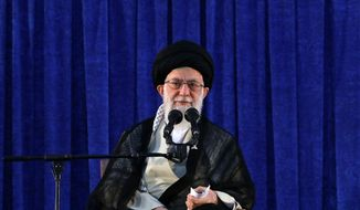 """In this picture released by an official website of the office of the Iranian supreme leader, Supreme Leader Ayatollah Ali Khamenei attends a ceremony marking the 29th anniversary of the death of the late revolutionary founder Ayatollah Khomeini, at his mausoleum, just outside Tehran, Iran, Monday, June 4, 2018. Iran's top leader says anyone who fires one missile at his country """"will be hit by 10"""" in response, but dismisses fears of war as """"propaganda"""" by the West. (Office of the Iranian Supreme Leader via AP)"""