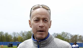 FILE - In this May 11, 2018, file photo, Hall of Fame quarterback Jim Kelly is shown at the Buffalo Bills NFL football rookie minicamp, in Orchard Park, N.Y.  Kelly says he's going to receive ESPN's Jimmy V Award for the toughness and perseverance he's displayed during his ongoing battle with oral cancer. Kelly says cable network officials informed him about 10 days ago that he will receive the honor at the ESPY Awards next month. (AP Photo/Jeffrey T. Barnes, File)