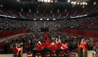 In this photo taken May 22, 2018, members of the Culinary Workers Union, Local 226, assemble for a presentation in a university arena before an evening vote on whether to authorize a strike in Las Vegas. The union representing Las Vegas casino-hotel workers has reached tentative agreements for new contracts with two companies that employ more than two-thirds of the 50,000 workers threatening to strike and is now focusing on negotiations with smaller casino operators. The Culinary Union on Monday, June 4, 2018, said it is turning its attention to 15 properties that still need contracts, including Tropicana, Treasure Island, Golden Nugget and SLS. (Steve Marcus/Las Vegas Sun via AP)
