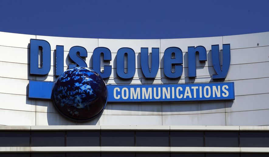 FILE - This is a July 31, 2017, file photo showing The Discovery Communications logo atop its headquarters in Silver Spring, Md. Discovery Inc. has signed a $2 billion agreement that gives it media rights to PGA Tour programming for its 220 markets outside the United States. The deal announced Monday, June 4, 2018,  is designed to allow Discovery to deliver golf around the world on every screen and device. It's the PGA Tour's latest effort to expand its fan base around the world. The 12-year deals starts next year and runs through 2030.  (AP Photo/Manuel Balce Ceneta, File)