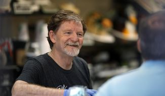 Baker Jack Phillips, owner of Masterpiece Cakeshop, manages his shop Monday, June 4, 2018, in Lakewood, Colo., after the U.S. Supreme Court ruled that his refusal to make a wedding cake for a same-sex couple because of his religious beliefs did not violate Colorado's anti-discrimination law. (AP Photo/David Zalubowski)