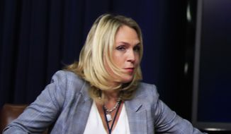 "In this March 22, 2018, file photo, special assistant to President Donald Trump, Kelly Sadler attends a forum at the Eisenhower Executive Office Building on the White House complex in Washington. The White House is refusing to condemn a staffer who said during a closed-door meeting that Arizona Sen. John McCain's opinion ""doesn't matter"" because ""he's dying anyway.""  (AP Photo/Manuel Balce Ceneta) ** FILE **"