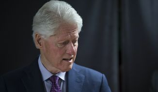 Former President Bill Clinton testified to investigators that he did not want to snub Attorney General Loretta E. Lynch when he walked the 30 yards from his private jet to hers. He told her she was doing a great job and that she was his favorite Cabinet secretary. (Associated Press/File)