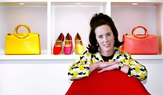 In this May 13, 2004, file photo, designer Kate Spade poses with handbags and shoes from her next collection in New York. Law enforcement officials say Tuesday, June 5, 2018, that New York fashion designer Kate Spade has been found dead in her apartment in an apparent suicide. (AP Photo/Bebeto Matthews, File)