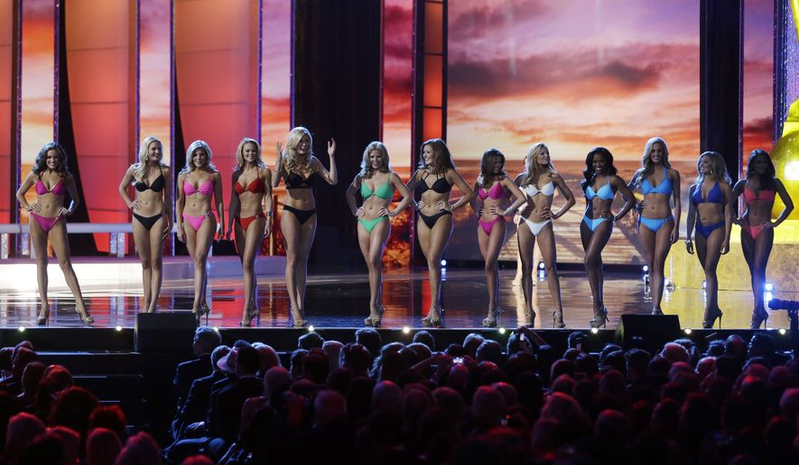 """FILE - In this Sept. 13, 2015, file photo, contestants wear swimsuits as they compete in the 2016 Miss America pageant in Atlantic City, N.J. The Miss America Organization is dropping the swimsuit competition from its nationally televised broadcast, saying it will no longer judge contestants in their appearance. Gretchen Carlson, a former Miss America who is head of the organization's board of trustees, made the announcement Tuesday, June 5, 2018, on """"Good Morning America."""" (AP Photo/Mel Evans, File)"""