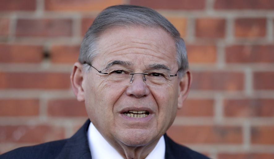 U.S. Sen. Bob Menendez speaks to reporters after casting his vote in the New Jersey primary election Tuesday, June 5, 2018, at the Harrison Community Center in Harrison, N.J. (AP Photo/Julio Cortez)