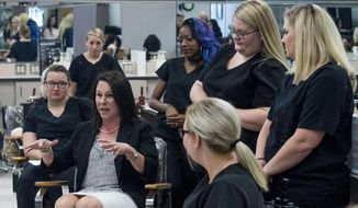 U.S. Representative Martha Roby talks with cosmetology students as she tours the Lurleen B. Wallace Community College MacArthur Campus in Opp, Ala. on Wednesday May 30, 2018, while campaigning for re-election in south Alabama. (Mickey Welsh /The Montgomery Advertiser via AP)
