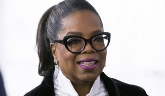 "FILE - In this Oct. 21, 2017 file photo, Oprah Winfrey arrives for the David Foster Foundation 30th Anniversary Miracle Gala and Concert, in Vancouver, British Columbia. Winfrey's next book club pick is,,""The Sun Does Shine: How I Found Life and Freedom on Death Row,"" a memoir about a wrongful murder conviction and the long fight to win acquittal. (Darryl Dyck/The Canadian Press via AP, File) **FILE**"