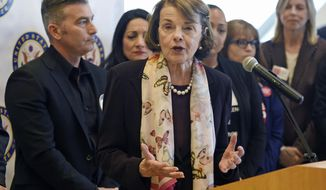 FILE - In this March 27, 2018 file photo, Democratic California Sen. Dianne Feinstein addresses reporters after hosting a roundtable discussion on gun safety with gun violence survivors, family members, activists and medical personnel at the UCLA Medical Center in Los Angeles. Feinstein is facing a challenge from fellow Democrat Kevin de Leon, currently California state Senate president pro tem, in the upcoming California Primary on June 5.  (AP Photo/Chris Pizzello, File)