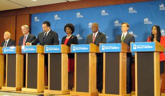 Democratic candidates for Maryland governor, from eft, Jim Shea, state Sen. Richard Madaleno, former NAACP head Ben Jealous, Valerie Ervin, Prince George's County Executive Rushern Baker, Alec Ross and Krish Vignarajah, prepare to begin a debate, Tuesday, June 5, 2018 in Baltimore. (AP Photo/Brian Witte)