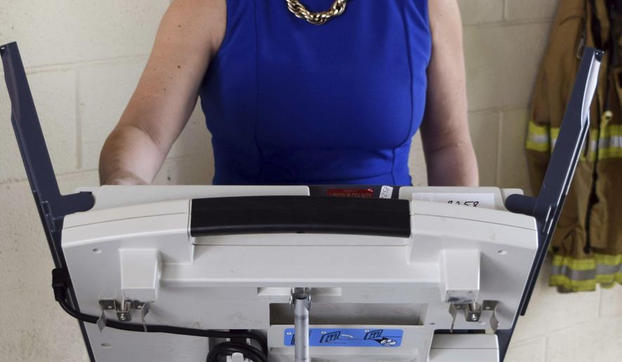 Republican State Sen. Sally Doty, a candidate for the Third Congressional District seat, left, votes in the party primary, at a Brookhaven, Miss., fire station, Tuesday, June 5, 2018. (Adam Northam/The Daily Leader via AP)
