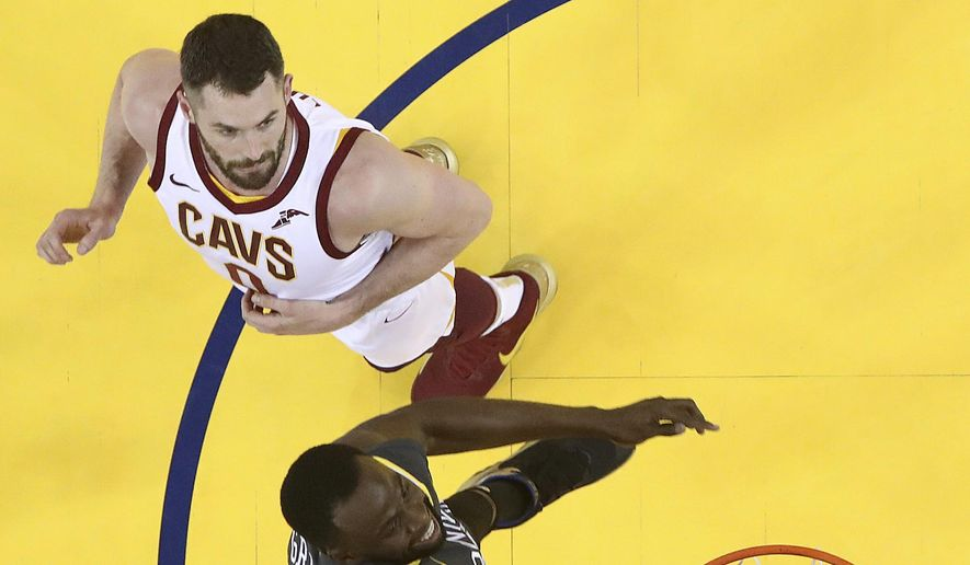 Golden State Warriors forward Draymond Green, bottom, dunks in front of Cleveland Cavaliers forward Kevin Love during the first half of Game 2 of basketball's NBA Finals in Oakland, Calif., Sunday, June 3, 2018. The Warriors won 122-103. (Ezra Shaw/Pool Photo via AP)
