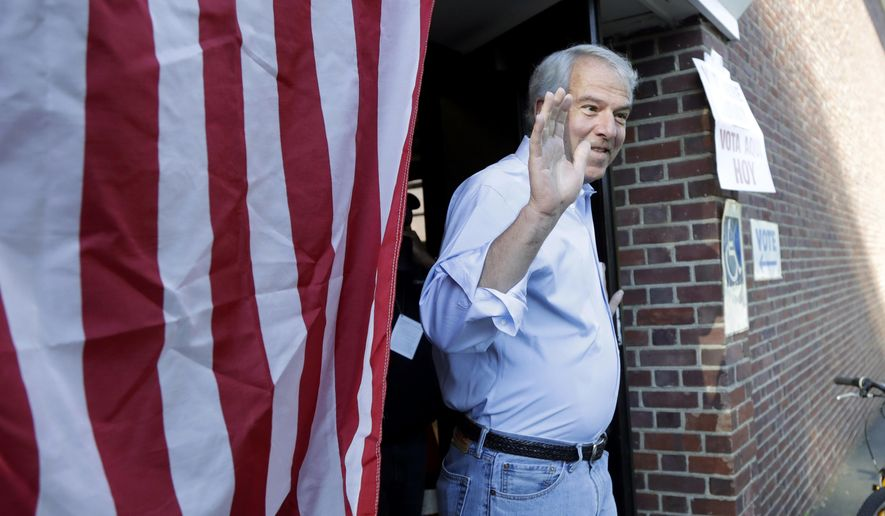 Bob Hugin, a Republican candidate running in New Jersey primary election for U.S. Senate, gestures while exiting his polling place after casting his vote in the New Jersey Primary Election, Tuesday, June 5, 2018, at the Lincoln-Hubbard School in Summit, N.J. (AP Photo/Julio Cortez)
