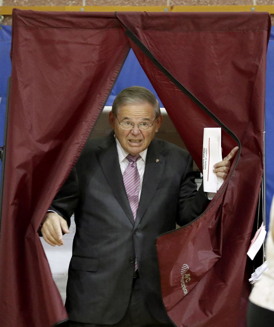 U.S. Sen. Bob Menendez exits a polling booth after casting his vote in the New Jersey primary election, Tuesday, June 5, 2018, at the Harrison Community Center in Harrison, N.J. (AP Photo/Julio Cortez)