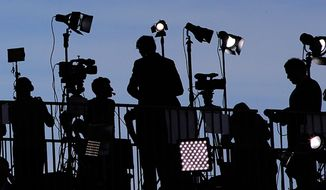 "Americans now say they have ""news fatigue"" says a new Pew Research Center poll. (AP Photo; file)"