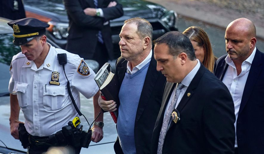 In this May 25, 2018, file photo, Harvey Weinstein arrives at the first precinct while turning himself to authorities following allegations of sexual misconduct in New York. Weinstein is scheduled to be arraigned in New York on rape and criminal sex act charges. The hearing on Tuesday, June 4, in NY's Manhattan borough comes after a grand jury indicted the former movie mogul on charges involving two women. (AP Photo/Andres Kudacki, File)
