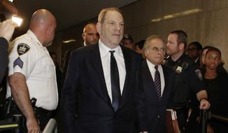 Harvey Weinstein, second left, accompanied by his attorney Benjamin Brafman, third left, arrives for his appearance in Supreme Court, in New York, Tuesday, June 5, 2018. Weinstein pleaded not guilty Tuesday to rape and criminal sex act charges in New York. The hearing in Manhattan comes after a grand jury indicted the former movie mogul last week on charges involving two women. (AP Photo/Richard Drew)