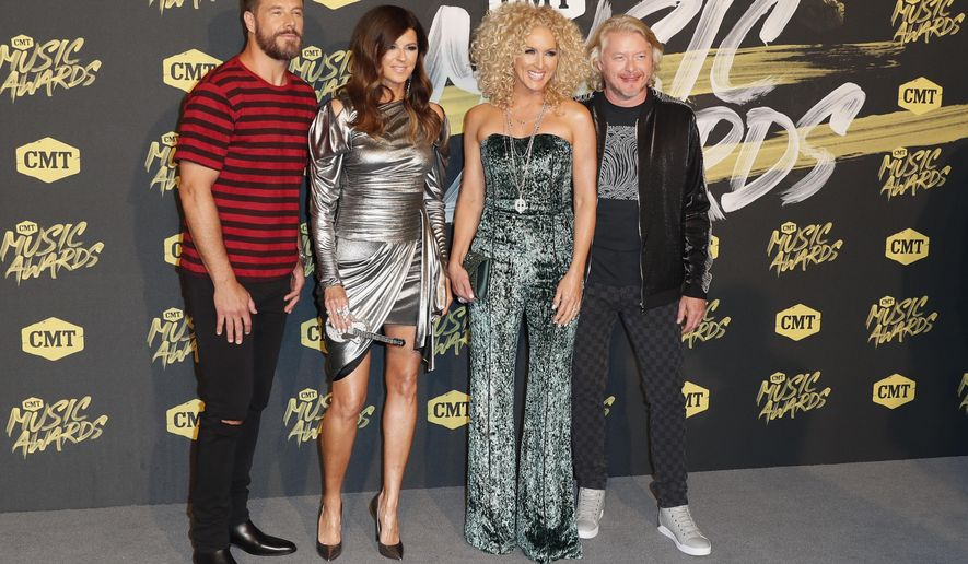 Jimi Westbrook, from left, Karen Fairchild, Kimberly Schlapman and Phillip Sweet, of Little Big Town, arrive at the CMT Music Awards at the Bridgestone Arena on Wednesday, June 6, 2018, in Nashville, Tenn. (AP Photo/Al Wagner)