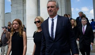 Robert F. Kennedy, Jr. and his wife, Cheryl Hines, (center) honor the anniversary of Robert F. Kennedy's death. Kennedy was presidential candidate.